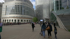 Adults and children walking in Reuters Plaza in Canary Wharf, London Stock Footage