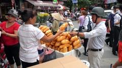 Street Vendor Selling Baguettes on Vietnam Street Stock Footage