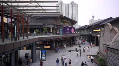 Shoppers walking in Chengdu Sino-Ocean Taikoo Li business district Stock Footage