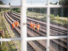 Railway workers on tracks, view from signal box Stock Photos