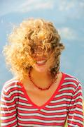 Smiling woman's hair blowing in wind Stock Photos