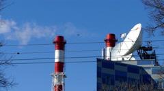 Smoking Chimneys and Antennas . - stock footage