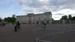 Lady controlling the bicycles traffic in front of Buckingham Palace in London Stock Footage