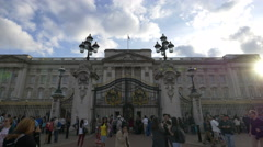 Tourists looking at Buckingham Palace from behind the gates in London Stock Footage