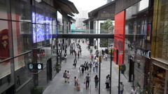 Shoppers in Chengdu Taikoo Li business district Stock Footage