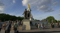 Tourists visiting Victoria Monument on a sunny day in London Stock Footage