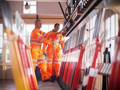 Railway signalmen in signal box pulling lever Stock Photos
