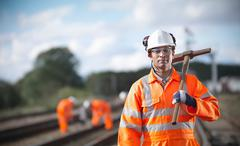 Railway worker holding tool Stock Photos