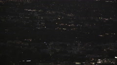 Helicopter flies over city (panning) (UNGRADED) Stock Footage
