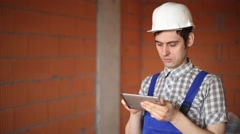 Worker taking pictures and doing calculations with your tablet - stock footage