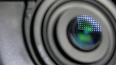 Camera lens blured and light reflection in optics - quick transition, loop Stock Footage