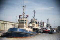 Tugs in harbour - stock photo