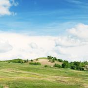 Mountainous terrain and the blue sky - stock photo