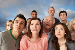 Group of people looking up - stock photo