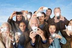 Group of people taking photographs - stock photo