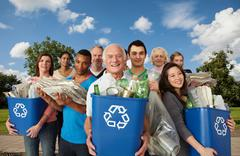 Group of people with recycling in bins Stock Photos