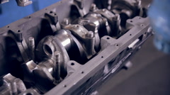 Worker making a car engine Stock Footage
