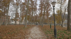 Man and woman walking in the park of the Congress square in Ljubljana Stock Footage