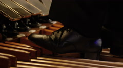 Feet playing foot pedals on pipe organ Stock Footage