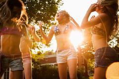 Girls dancing in garden Stock Photos