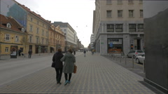 Ladies walking on Slovesnka street in Ljubljana Stock Footage