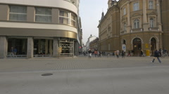 Old couple and old ladies crossing Slovenska street in Ljubljana Stock Footage