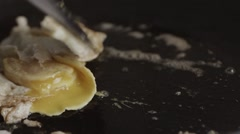 An egg is fried unsuccessful Stock Footage