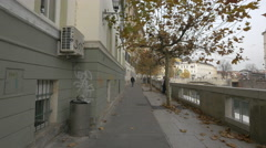People walking, chatting and relaxing by the river in Ljubljana Stock Footage
