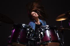 Drummer playing the drums Stock Photos