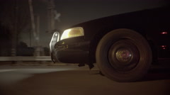 Police car driving through suburbs at night (front side) (UNGRADED) - stock footage