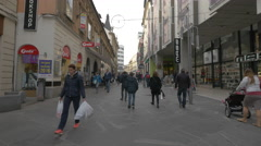 Crowded street with stores and restaurants in Ljubljana Stock Footage