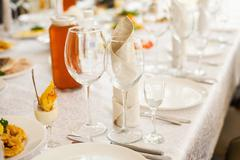 Table served with different food and flatware.  - stock photo