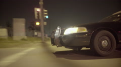 Police car night drive exterior through suburbs (UNGRADED) Stock Footage