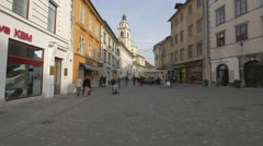 Old ladies and mom with a stroller walking in the old city center in Ljubljana Stock Footage