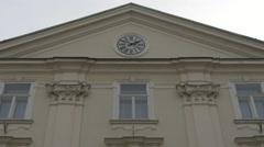 Building facade with clock in Ljubljana Stock Footage