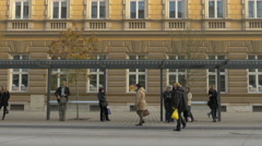 People walking and waiting in the bus station in Ljubljana Stock Footage