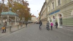 Family with a little baby walking in the Congress Square in Ljubljana Stock Footage