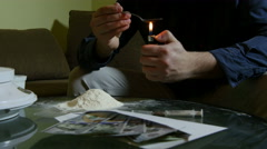 Junkie with lighter heating spoon with heroin, preparing drug dose for syringe. Stock Footage