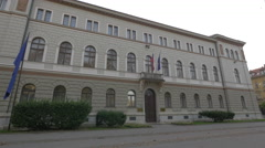 Facade of a white old building in Ljubljana Stock Footage