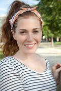 Stock Photo of Young woman wearing headscarf, portrait