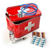 First aid kit with stethoscope, pills and syringe on the table. Stock Illustration