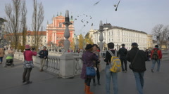 Tourists taking pictures on Triple Bridge in Ljubljana Stock Footage