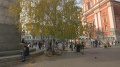 Old lady with bags walking through Preseren Square in Ljubljana Stock Footage
