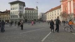 Couple wearing sunglasses and walking in Preseren Square in Ljubljana Stock Footage