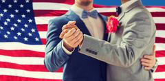 Close up of happy male gay couple dancing Stock Photos