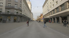 Youngsters, adults and old people crossing the Slovenska street in Ljubljana Stock Footage