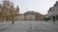 Lady with baby in the stroller walking in the Congress Square in Ljubljana - stock footage