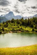 Lake in grassy rural landscape Stock Photos