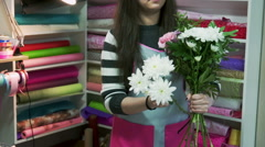 Florists create bouquets in flower shop Stock Footage