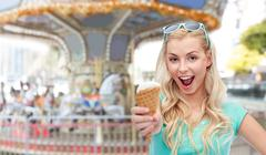 Happy young woman in sunglasses eating ice cream Stock Photos